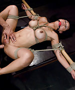 Tia gets fucked in tight bondage