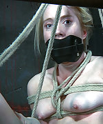 Blond slut in a tight sadistic bondage