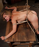 Bound ass out over a table, stripped, slapped and vibed