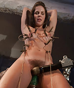 Tied down, tits clamped and machine fucked