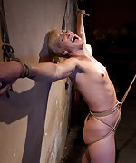 Bound to wall, abused with crotch rope, made to squirt