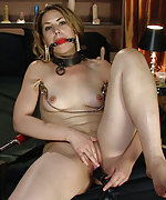 Tits clamped, butt plugged, dildoed, machine fucked