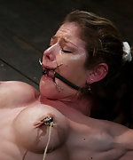 Huge titted milf is gagged and bound in hard metal