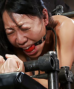 Asian milf bound in metal and ass fucked by machine