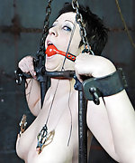 Metal bondage, clamps, hood, gags, suspension