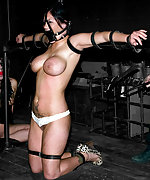 Two brunettes in live bondage show