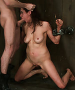 Donna is bound in hard metal, helpless and sucking and fucking huge cock