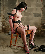 Dark haired beauty gets her pussy stuffed and her titties clamped