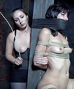 Brunette gets roped, tightly gagged, pegged and vibed