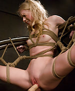 Blond beauty roped, suspended and machine fucked