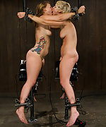 Two girls clamped, cuffed and gagged together
