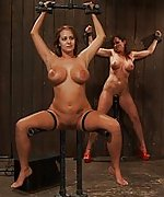 Three busty girls in metal bondage