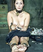 Cute girl handcuffed, chained and trained