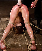 Bound tightly in pile driver, fisted anally, double penetrated