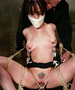 Hot sexy girl is tied, gagged, suspended