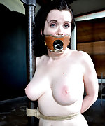 Naked, roped to the chair, tits clamped, caned